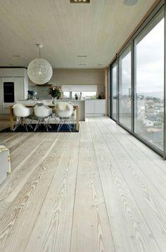 Blonde floor boards & floor to ceiling windows.