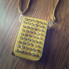 D'ORCIA MUSTARD STUDDED CROSSBODY MINI WALLET New with tags D'Orcia mustard color CROSSBODY. Small defect: one stud is a tad dented but you can't tell unless you look closely. This little bag fits all the essentials. D'Orcia Bags Crossbody Bags