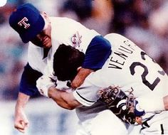 Nolan Ryan (Rangers) puts Robin Ventura (White Sox) in a headlock.  After Ventura was plunked by a Ryan fastball, he quickly charges at Ryan. Ventura is rudely greeted by a headlock and a flurry of punches to his noggin. This is easily the most one-sided brawl ever...