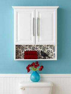 Easy Decor--A simple print can make a big different in a plain room. Add pattern to a boring open shelf easily with a piece of peel-and-stick repositionable wallpaper. Use a sheet of this paper to fill the open shelf for instant design and satisfaction.