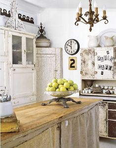 Love the rustic island in this shabby chic kitchen <3