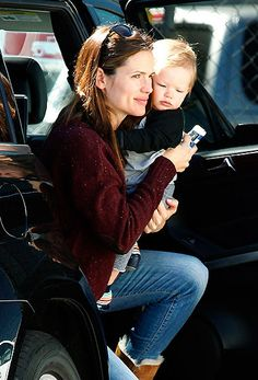 Jennifer Garner cradled son Samuel heading to a toy store in L.A.'s Brentwood nabe on Feb. 26 — Sam's first birthday!