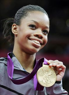 S. gymnast Gabrielle Douglas displays her gold medal Thursday during the artistic gymnastics women's individual all-around competition at the 2012 Summer Olympics, in London.