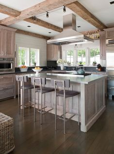 Silvery gray. A light gray stain will give your cabinets character, i. This kitchen has a lot of wood in it, but because the cabinetry color is not a typical wood tone, there's enough variation to keep it from appearing too woodsy.