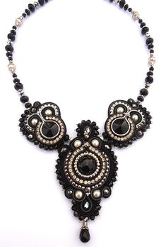 Black Miranda by Cielo Design, via Flickr. it's a beautiful piece, but when i look at the two smaller pieces i see  monkey faces. there's something seriously wrong with that. LOL