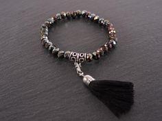 Bracelet élastique cristaux et pompon noir