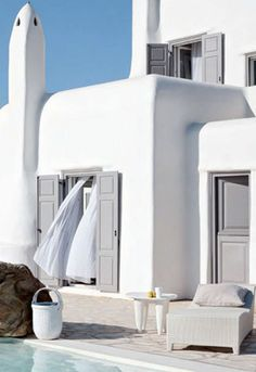 pThis family home on the Greek island of Mykonos shows off the refreshing Greek architecture that we all love so much. It has beautiful soft curved corners, crisp white walls, and iconic furniture pieces scattered throughout.�/pp�/p