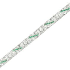 Platinum, Diamond and Emerald Bracelet  The pierced bracelet centering a line of 7 old European-cut diamonds approximately 2.00 cts., set throughout with 139 old European and single-cut diamonds approximately 4.85 cts., spaced by ribbons of calibre-cut emeralds, circa 1920