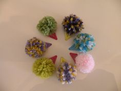 Love these!  A new twist on hair accessories for little girls!!!  Cute cute cute!  And she puts them on headbands too.