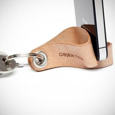 Objekten Keyring, made from recycled bonded leather, features a unique cut offering smartphone docking capability.