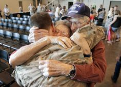 """Spc. Asa Barrett hugs his grandparents Dorothy and Clifford """"Bud"""" Boyd as he and his brother, Spc. Mason Barrett, along with approximately 180 other soldiers with the Oklahoma National Guard return home from their recent deployment in Afganistan and Kuwait."""