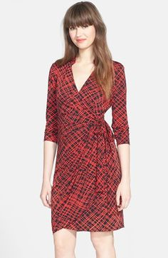 I like the print but not the color combo. When the pic is smaller is looks more like blue and orangish pink, which would be better than stark black and red. The top part of the neck is also a little strange but the shape is promising | Maggy London Print Jersey Wrap Dress available at #Nordstrom