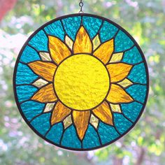 Stained Glass Sunburst Round Suncatcher by livingglassart home of oddballs and oddities, via Flickr