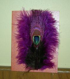 Unique design; peacock feather, surrounded by  plum feathers.   www.facebook.com/uniquelyvalentine
