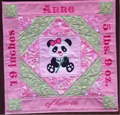 This small wall hanging is for one of my darling nieces. In fact, it is the center panel in a group of three wall hangings that include all of the baby's vital statistics. Yes, I have covered up so...
