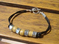 Mens black leather bracelet with steel nuts and by dzinebug, €13.00