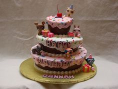 Littlest Pet Shop Birthday Cake Carved 10, 8 and 5 in white cake. Filled with strawberries and SMBC. Frosted in Sugar Shack frosting and...