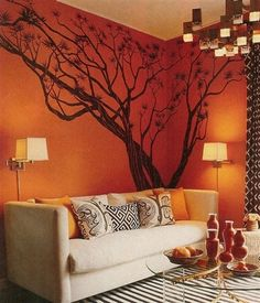 family room with dramatic tree mural