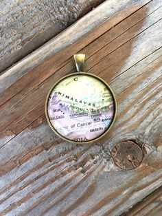 Globe Pendant Necklace or Keychain Himalayas Nepal Map World Travel Wanderlust Gift for Traveler Earth Nation by IndustrialWhimsy on Etsy https://www.etsy.com/listing/400791463/globe-pendant-necklace-or-keychain