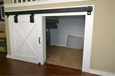 Dog room under stairs with mini barn door Door Under Stairs, Space Under Stairs, Basement Stairs, Mini Barn, Dog Spaces, Dog Rooms, Secret Rooms, Stair Storage, Deco Design
