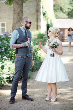 Super Cool Couple | A vintage short wedding dress | home wedding | yurt reception | DIY decor | Bouquet by Swallows and Damsons | Groom in a tweed suit | Image by Emma B Photography | http://www.rockmywedding.co.uk/katherine-rich/
