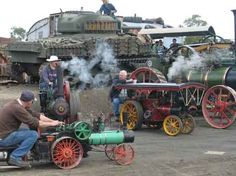 miniature engines with tank in the background