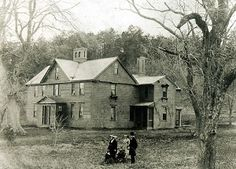 Louisa May Alcott, her mother Marmee, her father Amos, her older sister Anna, and Anna's first-born son Frederick, in front of Orchard House in Concord circa 1865.