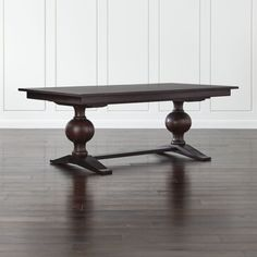 Shop Winnetka Rectangular Extendable Dining Table.   The option of two leaves expands the solid wood table's seating capacity from 8 up to 12 using both leaves.  The Winnetka Rectangular Extension Pedestal Dining Table is a Crate and Barrel exclusive.