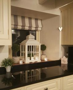 Love these white lanterns....they really bring out the striped blinds....country kitchen