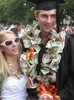 celebration money lei with dollar bills, candy kisses and ribbon. added colored ribbon to tie in the school colors and used paint markers to write the school letters and 2010.