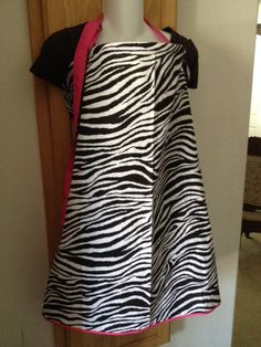 Breastfeeding cover,nursing cover like hooter hider zebra with hot pink  outline detail and straps Lightweight cotton breathable. $22.99, via Etsy.