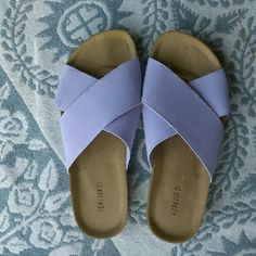 Purple strap slides Super cute light purple crossed strap slip ons from forever. Only worn once for a few hours (too small for me). No foot indents or discoloration. These have a cute burkenstock feel to them. And a white rubber soul to add a pop of contrast. Size 7. Great for summer by the pool. Forever 21 Shoes Sandals