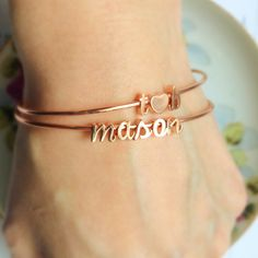 Personalized stacking bangles make the perfect Mother's Day gift!    Build Your Own Bangle listed in our Etsy shop, link in profile.   #tomdesignshop #etsy #customjewelry #personalizedjewelry #etsyshop