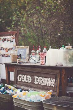 Vintage tin tubs for cold drinks and DIY sign for backyard wedding