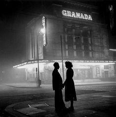 A young woman  talks to her boyfriend after her evening's work as a cinema usherette, London, 1954, a photo by Bert Hardy shegreeneyes...