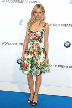 Sienna Miller looked charming in a floral Dolce & Gabbana dress at the BMW i3 Global Reveal Party
