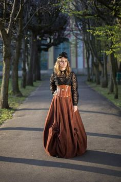 Unique long brown steampunk skirt with one hoop. Drapery decorated with little ribbon bows and carved antique gold color buttons. Made of polyester fabric thats like suede in touch. Ribbon bows are made of organza.  Dimensions: Waist: 64cm/25inch Lenght: 110cm/43inch