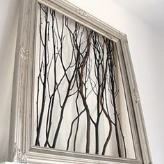 Did this in the dining room. White frame w/ silver branches.  Amazing what you can do with stuff in your backyard :)