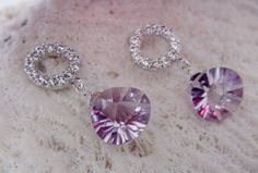 Cubic zirconia stud earrings with silver posts and a sparkling pink amethyst briolette.