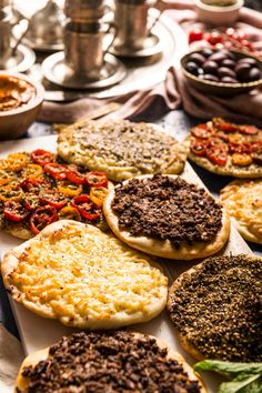 Middle Eastern pizzas with zaatar, halloumi cheese, spiced meat and tomatoes eastern food recipes lebanon Manakish 4 Ways (Middle Eastern Pizzas) Middle East Food, Middle Eastern Recipes, Middle Eastern Bread, Middle Eastern Decor, Middle Eastern Dishes, Lebanese Recipes, Greek Recipes, Arabic Recipes, Turkish Recipes
