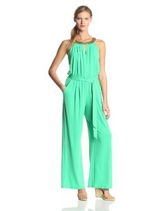 Green jersey jumpsuit with keyhole cutout and gold neckline #beading