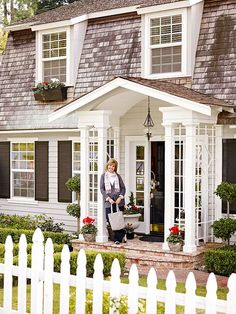 Layer On the Charm Give your exterior a polished look with character-boosting details. This Dutch Colonial's entry addition features a focalpoint portico with elegant trim, outdoor lighting, and a glossy black door with sidelights. Window boxes, a white picket fence, and a brick pathway framed by low-trimmed shrubs amplify the home's Nantucket charm.