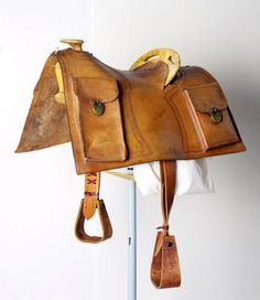 Pony Express Saddle with the lockable Mochilla Pouches to carry the mail. The saddle is designed to minimize weight and maximize function. At way-stations a saddled horse would be waiting and only the Mochila (the outer shroud with the mail pouches) would be switched to the new horse.