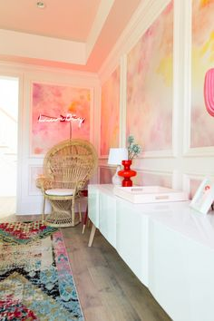 Pinks, reds, and yellow tones bring some tropical flair to this feminine office!