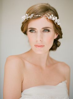 The Florence headpiece is a modern interpretation of a crown of jewels. Delicate branches in gold tones and pearl detailing, reminiscent of springtime...r
