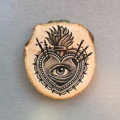Wood slice with an original drawing of a sacred door Inkspirednl
