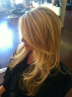 Lola loves this long layered cut...Create the beachy waves with either a round brush or a big barrel curling iron. www.lolabyginapayne.com