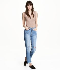 Check this out! 5-pocket jeans in washed denim with heavily distressed details. Regular waist, button fly, and straight legs with stripes at sides and asymmetric, raw-edge hems. - Visit hm.com to see more.