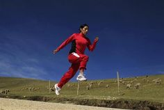 """Marathon runner Gladys Tejeda, the first Peruvian athlete who qualified for the 2012 London Olympic Games, runs during her training in the Andean province of Junin, May 14, 2012. A private company will take Tejeda's mother Marcelina Pucuhuaranga, 69, to London as part of the """"Thank you Mom"""" program. For Pucuhuaranga, who received her first passport, it will be the first time travelling out of Peru.  REUTERS/Pilar Olivares"""