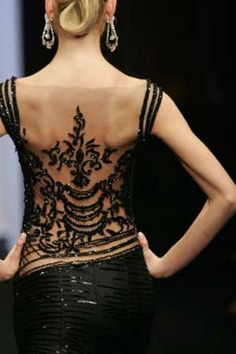 This gives new meaning to a bare back dress.  The detailing on this gown dresses your back up with 'faux ink' while keeping it elegant.